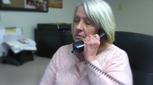Midwest Youth Services employee talking on the phone