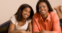 Photograph of a mentor smiling with her teen mentee.