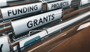 File folders with labels reading grants, funding, and projects