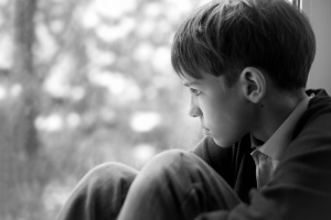 a boy looking out a window