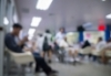 Teens sitting in chairs in a waiting area.