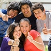 Photograph of a diverse group of cheerful young people.