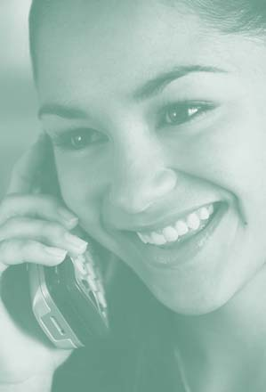 Photograph of a young woman talking on the telephone.