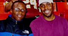 Mentee Darius and mentor Moses attend a football game